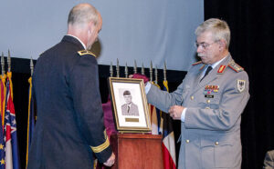 Lt. Gen. Jorg Vollmer, right, and CGSC Deputy Commandant Brig. Gen. John Kem unveil the IHOF portrait of Vollmer during the ceremony May 9. Click the photo for more images from the ceremony.