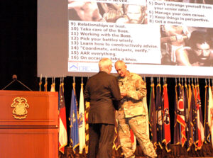 Foundation CEO Doug Tystad presents a coin to Lt. Gen. Brown after his farewell remarks to the CGSC faculty and students April 29.