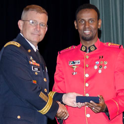 International officers receive graduation badges