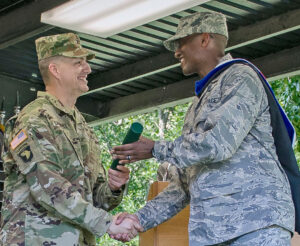 """Maj. Whitmore receives his MMAS from Col. Douglas Cardinale, Director of the Command and General Staff School, during the CGSOC Class of 2016 graduation on June 10. """" width=""""300"""" height=""""246"""" /> Maj. Whitmore receives his MMAS from Col. Douglas Cardinale, Director of the Command and General Staff School, during the CGSOC Class of 2016 graduation on June 10."""