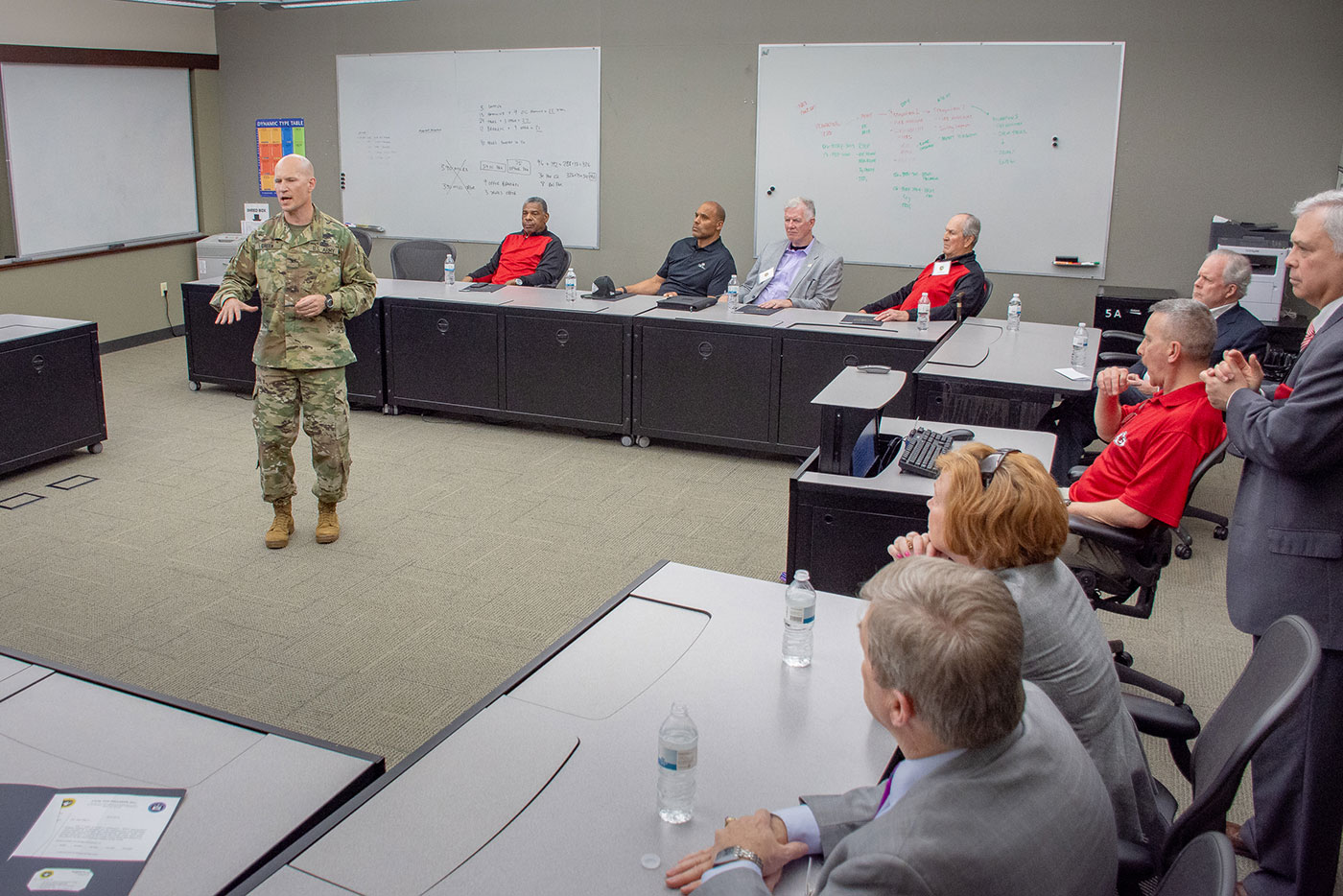 Col. Scott Green, director of CGSC's Department of Army Tactics, left, briefs the Kansas City Chiefs Ambassadors during their visit April 18. (photos by Dan Neal/ArmyU Public Affairs)