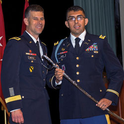 Photo of Major Moises Jimenez receiving the Colonel Thom Felts Leadership Award, an Army saber, from graduation guest speaker Brig. Gen. Robert F. Whittle, Jr., commandant of the U.S. Army Engineer School at Fort Leonard Wood, during the SAMS graduation ceremony May 23, 2019.
