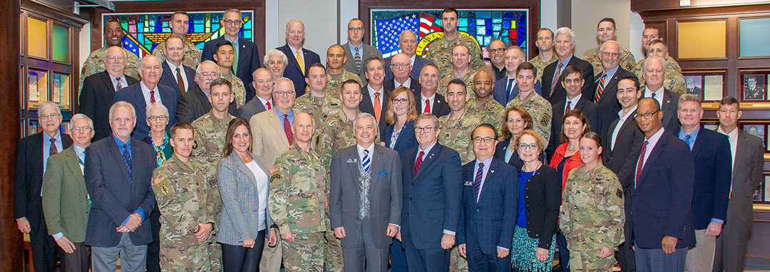 Group photo of the National Security Roundtable program guests, faculty and CGSC Foundation leadership in the atrium of the Lewis and Clark Center Oct. 2, 2019