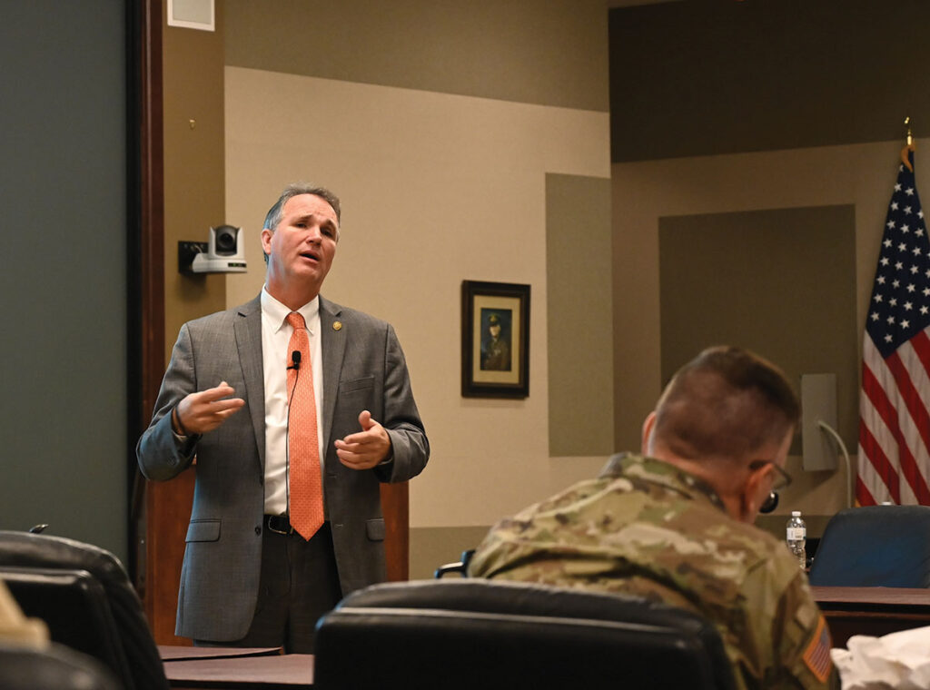Mr. Larry Hisle, the executive director of the Greater Kansas City Federal Executive Board, leads a discussion about the programs and mission areas of the Federal Executive Board during the InterAgency Brown-Bag Lecture conducted Nov. 26, 2019, in the Lewis and Clark Center's Arnold Conference Room.