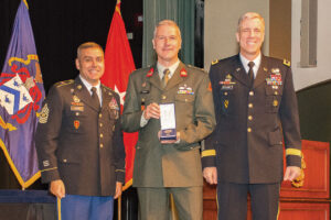 Netherlands Major Rene Berendsen receives the CGSC International Graduate Badge from Brig. Gen. Scott Efflandt, Provost of the Army University and Deputy Commandant of the Command and General Staff College, and Cmd. Sgt. Maj. Eric C. Dostie, Command Sergeant Major of the Combined Arms Center and the Command and General Staff College. (photos by Jim Shea/ArmyU Public Affairs)
