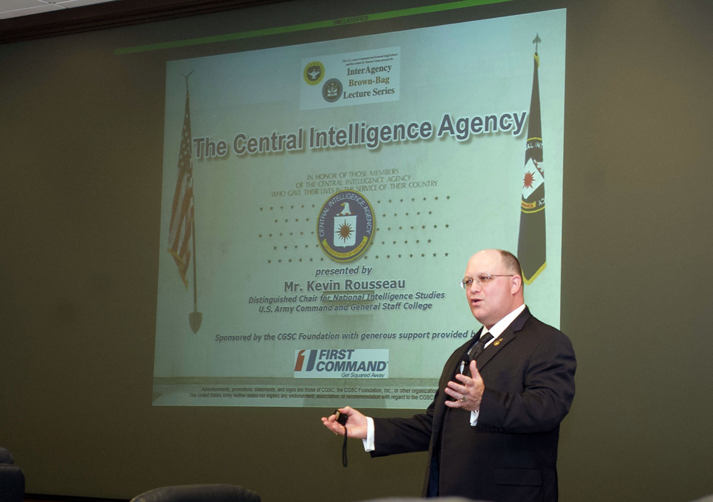 Photo of Kevin Rousseau, the CGSC Distinguished Chair for National Intelligence Studies and a member of the Central Intelligence Agency (CIA), delivering his presentation on the CIA in the latest the InterAgency Brown-Bag Lecture on April 3, in the in the Arnold Conference Room of the Lewis and Clark Center on Fort Leavenworth.