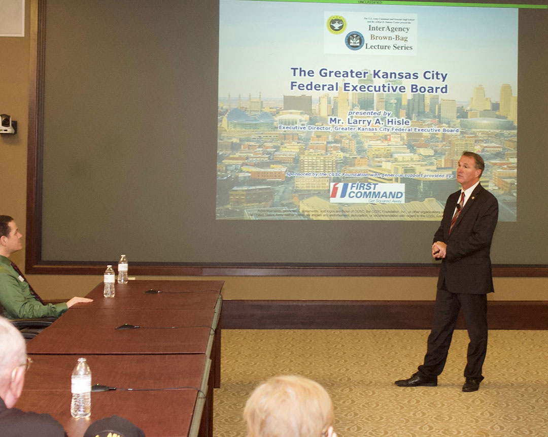 Mr. Larry A. Hisle, executive director of the Greater Kansas City Federal Executive Board, leads a discussion on the roles and missions of the Federal Executive Board in the Interagency Brown-Bag Lecture conducted May 8, 2019, in the Arnold Conference Room of the Lewis and Clark Center on Fort Leavenworth.