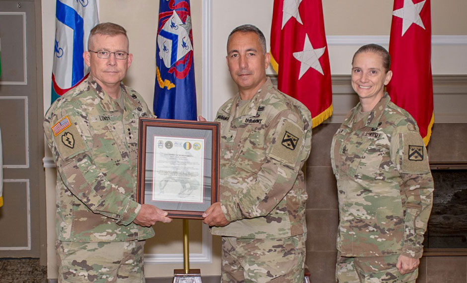 Brig. Gen. Stephen J. Maranian (center) accepts a framed copy of his assumption of responsibility orders from Lt. Gen. Michael D. Lundy, commander of the Combined Arms Center, Fort Leavenworth and commandant of the Command and General Staff College, during the ceremony on June 10, 2019. Maranian is accompanied by Command Sgt. Maj. Teresa Duncan (right), Provost Command Sergeant Major.