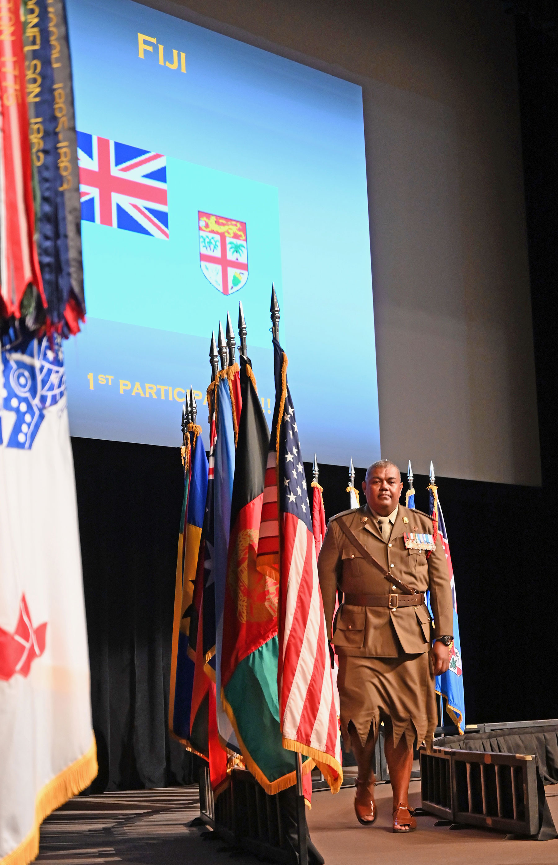 The first-ever international military student from Fiji marches off stage after posting his nation's colors during the CGSC Class of 2020 Flag Ceremony on Aug. 5, 2019.
