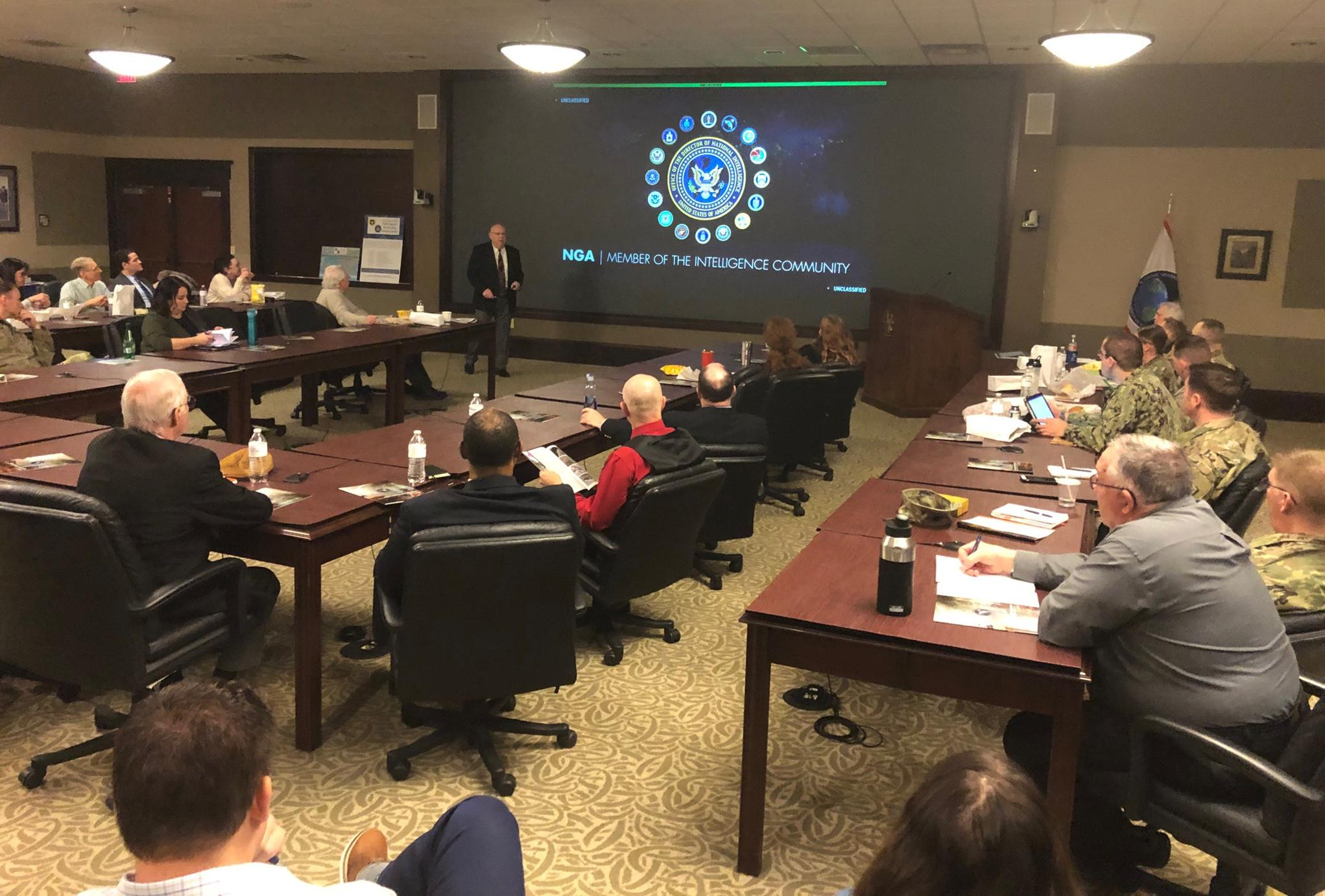 Mr. Ralph Erwin, Senior Intelligence Officer, speaks to students, faculty, and community members about theroles and missions of the National Geospatial-Intelligence Agencyduring the InterAgency Brown-Bag Lecture conducted Jan. 28, 2020, in the Lewis and Clark Center's Arnold Conference Room.
