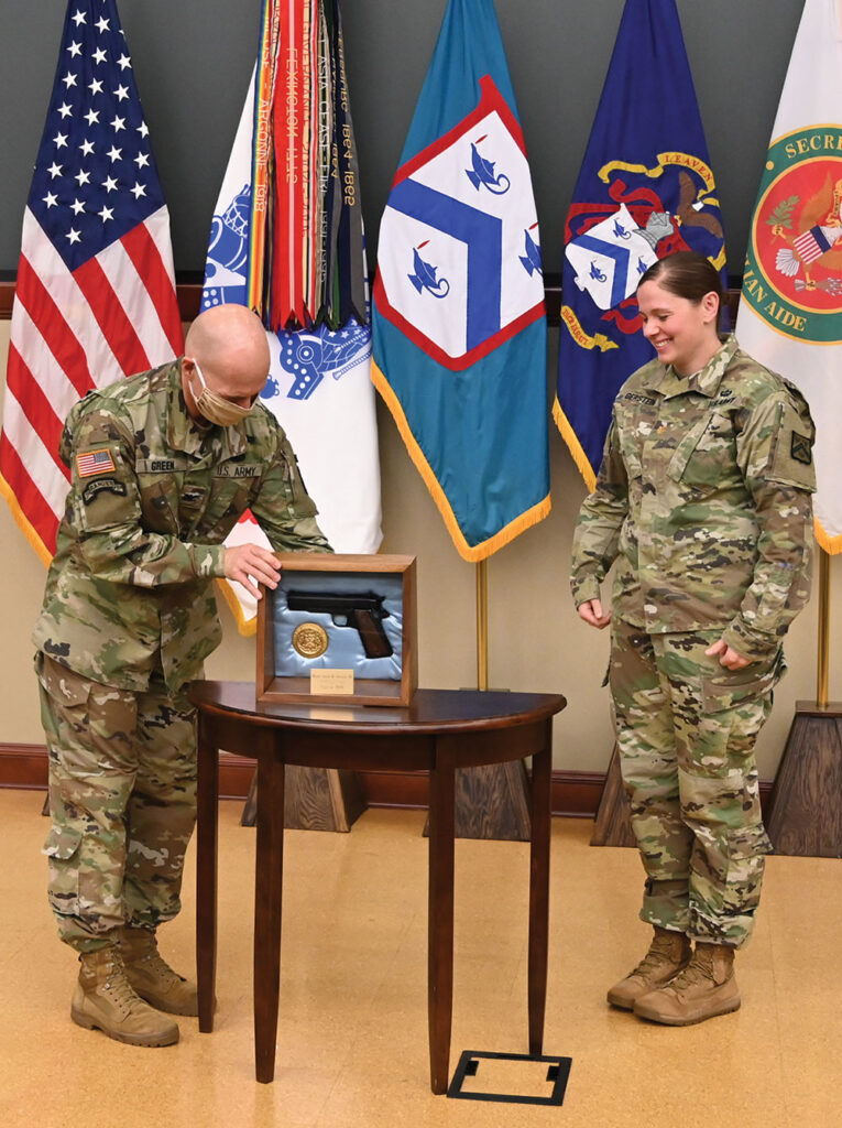 CGSS Director Col. Scott Green hosted the awards ceremony for the award recipients of the CGSOC Class of 2020 in Marshall Auditorium of the Lewis and Clark Center on June 11, 2020. The Marshall Award, the first award presented in the ceremony, went to Maj. Sarah M. Gerstein. As the first presenter, Green demonstrates how the COVID-19 compliant ceremony was to be conducted. Awards were to be placed on the table and after photos, the awards were picked up by the recipients.