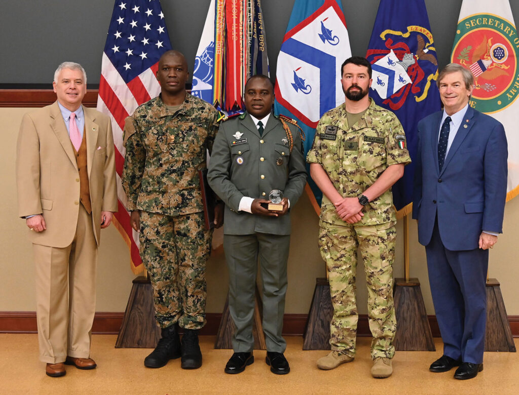 From left, CGSC Foundation President/CEO Rod Cox, Maj. Kevron W. Henry from Jamaica (2nd place - General Douglas MacArthur Military Leadership Writing Award), Capt. Abdel-Aziz Ali Orou from Benin (recipient of the Major General Hans Schlup Award), Maj. Alessio Battisti from Italy (recipient of the General Dwight D. Eisenhower Award and the Father Donald Smythe Military History Award) and Foundation Chairman Mike Hockley.