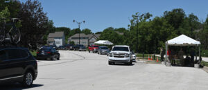 """In the world of virtual graduation ceremonies the outprocessing for CGSOC resident students also transitioned into a """"rodeo"""" style line in the student parking lot. Tents were set up with various stations by the CGSS staff to allow students to simply drive through and outprocess."""