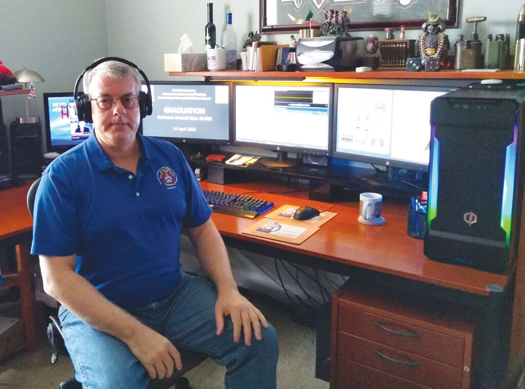 Assistant Professor Karl Restall, CGSC Directorate of Logistics and Resource Operations – Redstone Arsenal Campus, at his home office in Madison, Alabama. Restall produced the virtual graduation ceremony for the Redstone Campus. (photo by Renee Restall)