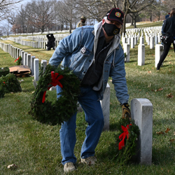 Foundation President/CEO Rod Cox assists with laying wreaths on Dec. 19, 2020, at the Fort Leavenworth National Cemetery.