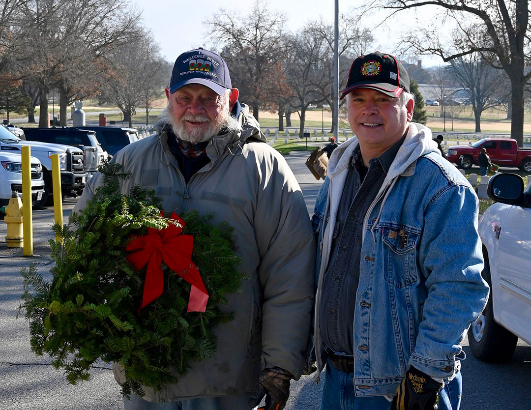 Col. (Ret.) Lynn Rolf, Jr., left, and CGSC Foundation President/CEO Rod Cox visit after laying wreaths on veterans' graves Dec. 19, 2020. Rolf was representing VFW Post 56 in Fort Leavenworth and has worked on the Wreaths Across America project for several years.