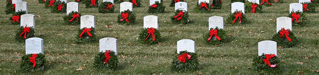 Image of wreaths on gravestones in the Fort Leavenworth National Cemetery- photo taken Dec. 19, 2020.