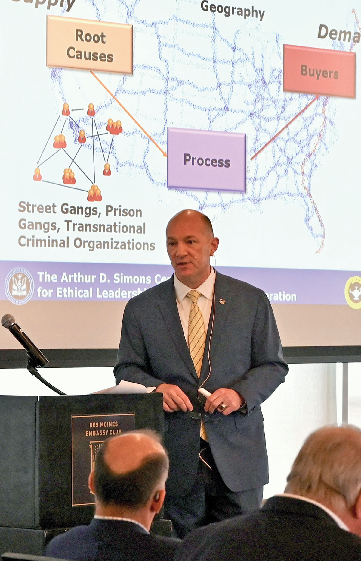 Lt. Col. (Ret.) John Nelson, chief executive officer of Morris, Nelson & Associates, LLC, and a senior research fellow of the Arthur D. Simons Center, delivers his presentation on Counter Human Trafficking at the Des Moines Embassy Club on May 20, 2021, in the inaugural event of the Simons Center National Security Forum.